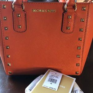 Orange studded statement Mini Mk purse